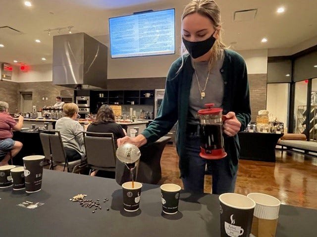 A seminar on coffee from history to brewing to taste will be presented by master coffee roaster Ulli Winckler, president of Rebel Coffee roastery in Cape Coral and a consultant at the Luminary Hotel in downtown Fort Myers, on May 15, part of a regular series of seminars Winckler will hold there.  Above, Dean Street Coffee barista Brooke Vance helps pour coffee for seminar attendees to taste