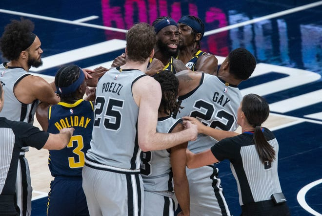 Apr 19, 2021; Indianapolis, Indiana, USA; Indiana Pacers forward JaKarr Sampson (14) and San Antonio Spurs forward Rudy Gay (22) get into a shoving fight in the fourth quarter at Bankers Life Fieldhouse. Mandatory Credit: Trevor Ruszkowski-USA TODAY Sports