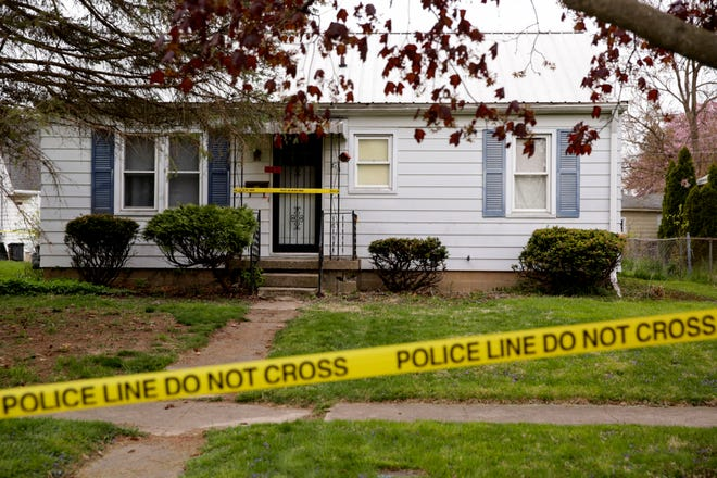 Crime scene tape is draped across a house on the 700 block of Park Avenue, Tuesday, April 20, 2021 in Lafayette.