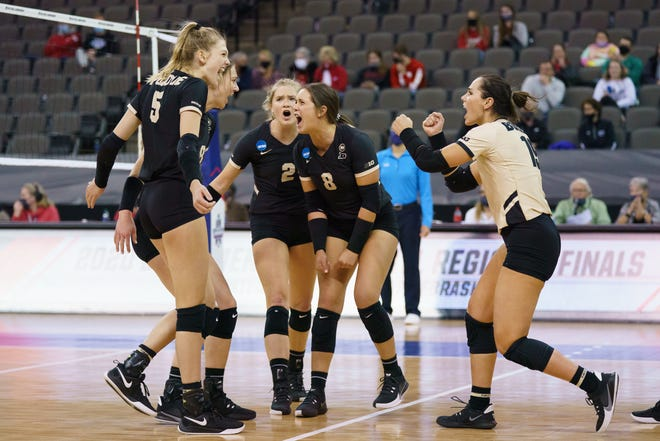Purdue celebrates a point against Kentucky during the Division I Women's Volleyball Tournament held at the CHI Health Center Omaha, Nebraska