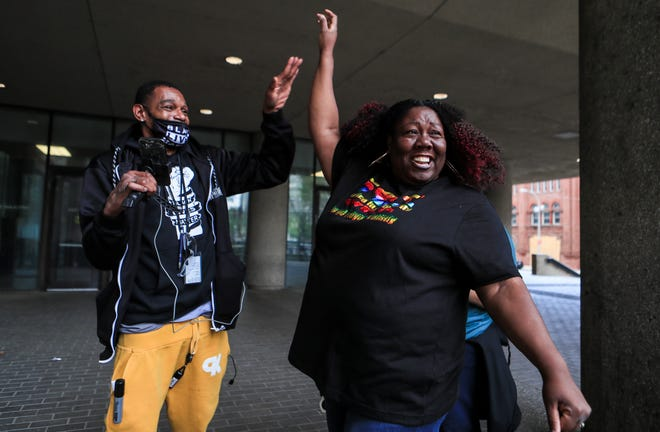 Bruce Sweeney celebrates with Gigi Love after former Minneapolis police officer Derek Chauvin was found guilty of murdering George Floyd on Tuesday.