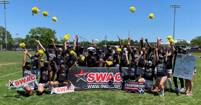 Members of the Alabama State women's soccer team celebrate winning the 2021 Southwestern Athletic Conference Tournament championship game vs. Grambling in Prairie View, Texas, on Sunday, April 11, 2021.