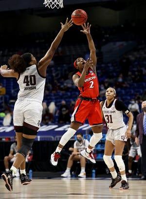 Former Texas A&M center Ciera Johnson (40) will begin her pro career with the Phoenix Mercury as a third-round draft pick. Johnson faced Arizona' Aari McDonald (2) in the NCAA Tournament.