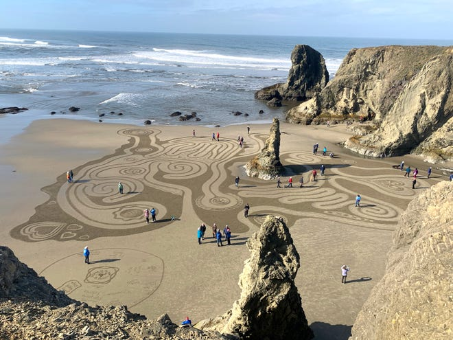 Visitors walk in the labyrinth designs created by Denny Dyke and the Circles in the Sand team, taken in early March of 2020 (pre-pandemic). The new season of Circles in the Sand began April 30.
