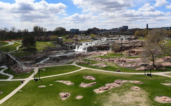 Clouds pass over Falls Park on Tuesday, April 20, 2021, in Sioux Falls.