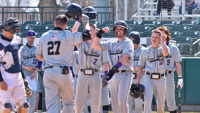 USF's Ryan Bernardy is greeted by teammates after a home run
