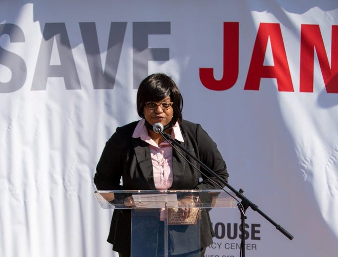 Ebonie Daniels, victim assistant coordinator for the Wichita County District Attorney's Office, reads pseudonyms of child victims April 1 during the Save Jane event at Patsy's House Children's Advocacy Center. The event was designed to raise awareness about child abuse.