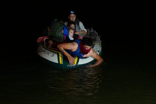 A smuggler takes migrants, mostly from Central American countries, on a small inflatable raft towards U.S. soil, in Roma, Texas. Mexico President Andres Manuel Lopez Obrador said Wednesday, April 14, 2021, it was protecting human rights that was motivating Mexico's efforts to stop child migrants en route to the U.S. from being smuggled into the country.