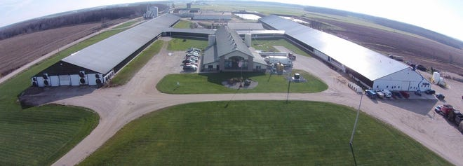 This aerial photo shows the Miltrim Farms' conventional parlor flanked by two freestall barns. The farm currently milks about 2,800 cows - 1,100 in a robot facility and the other 1,700 in a conventional parlor.