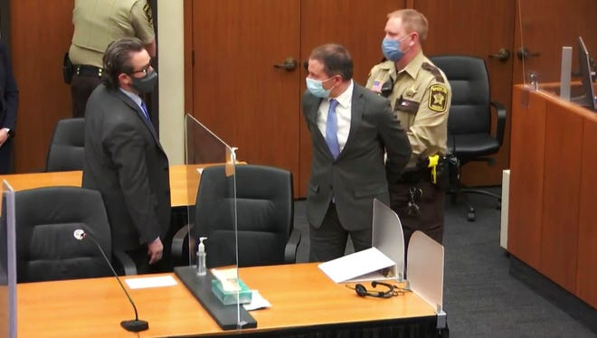 In this image from video, former Minneapolis police Officer Derek Chauvin, center, is taken into custody as his attorney, Eric Nelson, left, looks on, after the verdicts were read at Chauvin's trial for the 2020 death of George Floyd on April 20, 2021, at the Hennepin County Courthouse in Minneapolis.