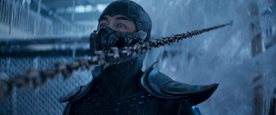 "Sub-Zero avoid a Scorpion thrown shot in ""Mortal Kombat."""