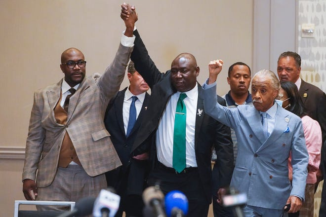 George Floyd's brother, Philonise Floyd, left; attorney Ben Crump; and the Rev, Al Sharpton react April 20 after learning that a jury had found former Minneapolis police Officer Derek Chauvin guilty of murdering George Floyd in 2020.