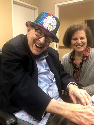 Sue Ducat and Stan Cohen celebrate Stan's 86th birthday in Rockville, Maryland, in January 2020.
