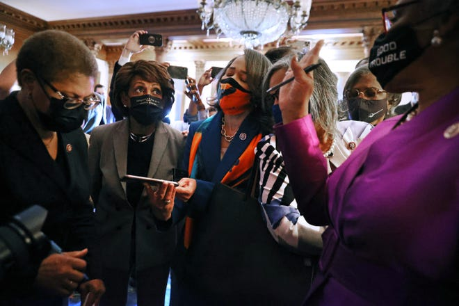 Members of the Congressional Black Caucus,  from left, Reps. Karen Bass, D-Calif.;  Maxine Waters, D-Calif.; Lisa Blunt Rochester, D-Del.; and caucus chair Joyce Beatty, D-Ohio, react to the verdict in the Derick Chauvin murder trial  April 20 in Washington. Chauvin was found guilty on all three charges in the murder of George Floyd.