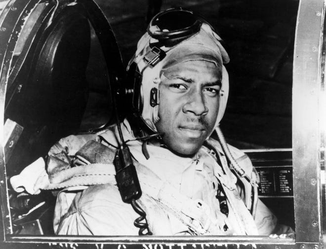 This circa 1950 photo released by the U.S. Navy shows Jesse Brown in the cockpit of an F4U-4 Corsair fighter at an unidentified location. Brown, the first African-American naval aviator, died when he crashed behind enemy lines during the Korean War.