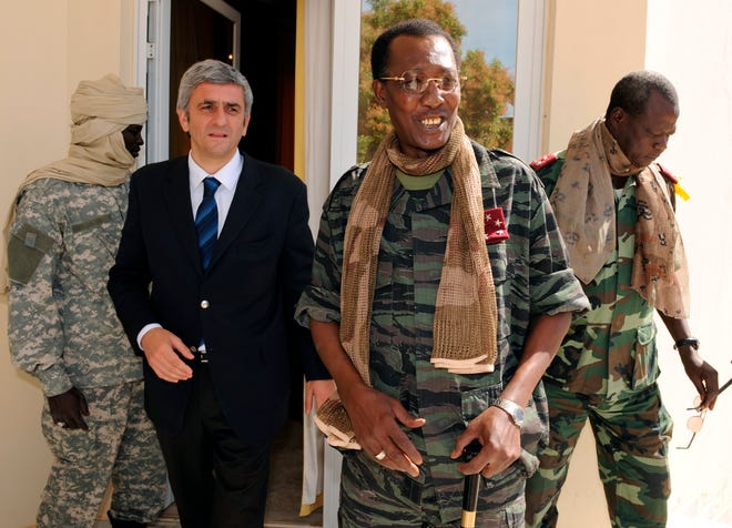 In this Feb. 6, 2008 file photo, Chad's President Idriss Deby Itno, center-right, meets with French Defense Minister Herve Morin, center-left, in N'Djamena, Chad. Deby, who ruled the central African nation for more than three decades, was killed on the battlefield April 20, 2021, in a fight against rebels, the country's top military commander announced on national television and radio.