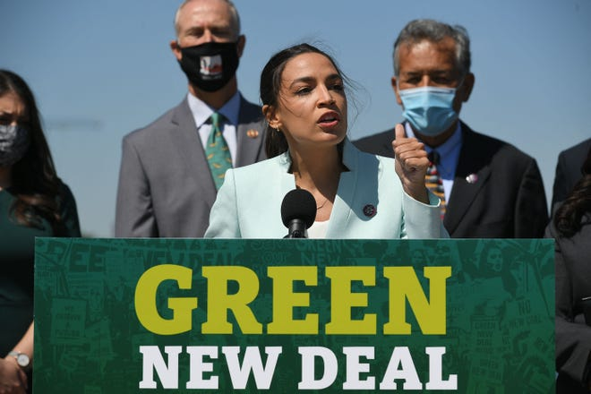 Rep. Alexandria Ocasio-Cortez, D-N.Y., speaks during a Tuesday press conference to reintroduce the Green New Deal.