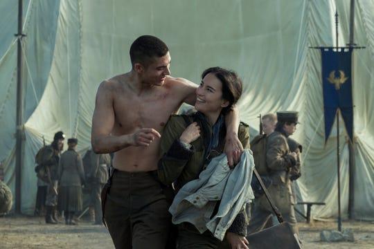 "Archie Renaux as Malyen Oretsev and Jessie Mei Li as Alina Starkov in ""Shadow and Bone"" on Netflix."
