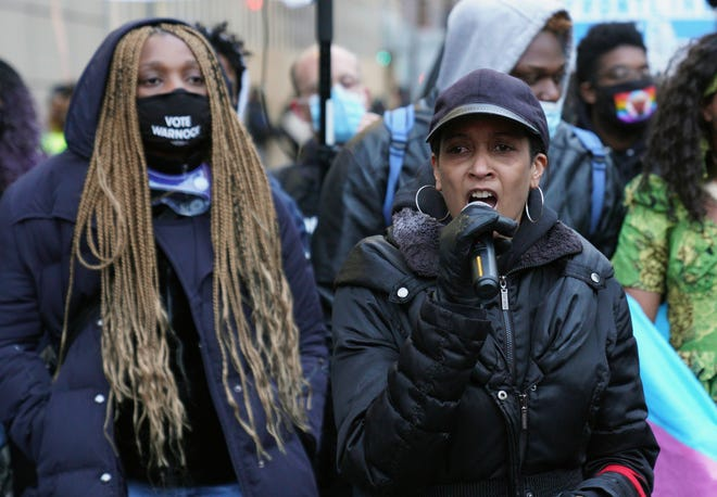 Monique Cullars-Doty speaks at a protest rally in downtown Minneapolis on the day jurors began deliberating in the trial of former police officer Derek Chauvin, who faces murder charges in the death of George Floyd.