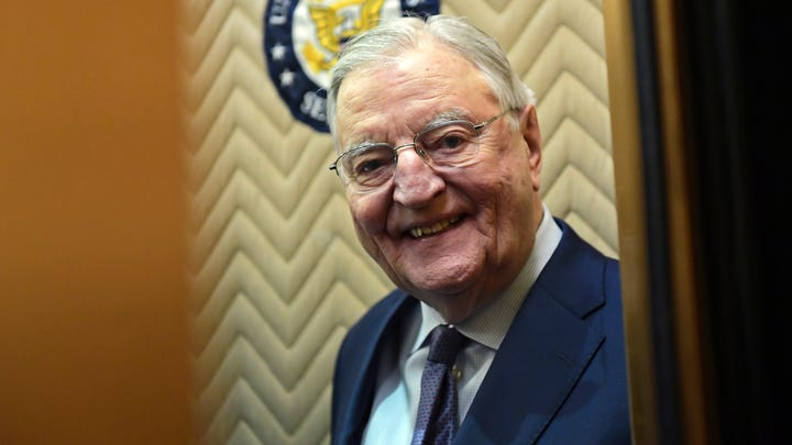 In this Wednesday, Jan. 3, 2018, file photo, former Vice President Walter Mondale smiles as he gets on an elevator on Capitol Hill in Washington. Mondale, a liberal icon who lost the most lopsided presidential election after bluntly telling voters to expect a tax increase if he won, died Monday, April 19, 2021. He was 93.