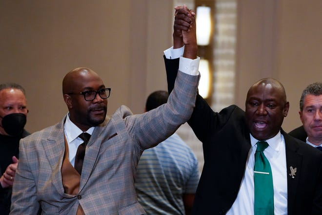 Philonise Floyd and Attorney Ben Crump, from left, react after a guilty verdict was announced at the trial of former Minneapolis police Officer Derek Chauvin for the 2020 death of George Floyd, Tuesday, April 20, 2021, in Minneapolis, Minn.