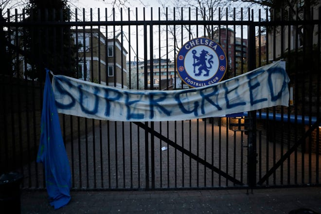 A banner hangs from one of the gates of Stamford Bridge stadium in London where Chelsea fans were protesting the proposed European Super League.