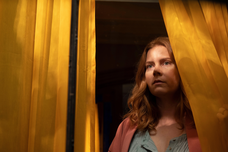 "Anna Fox (Amy Adams) is a paranoid agoraphobe in ""The Woman in the Window."""