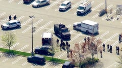 This aerial photo provided by WABC shows police responding to the scene of a shooting at a Stop & Shop supermarket in West Hempstead, N.Y., on Tuesday, April 20, 2021.