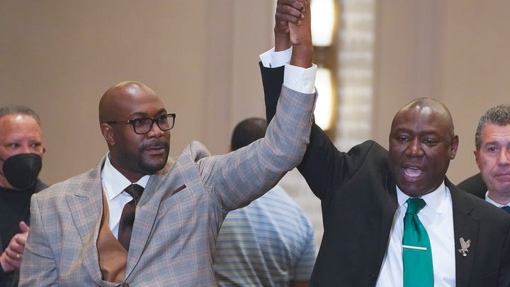 Philonise Floyd and Attorney Ben Crump, from left, react after a guilty verdict was announced at the trial of former Minneapolis police Officer Derek Chauvin for the 2020 death of George Floyd, Tuesday, April 20, 2021, in Minneapolis, Minn. Former Minneapolis police Officer Derek Chauvin has been convicted of murder and manslaughter in the death of Floyd.