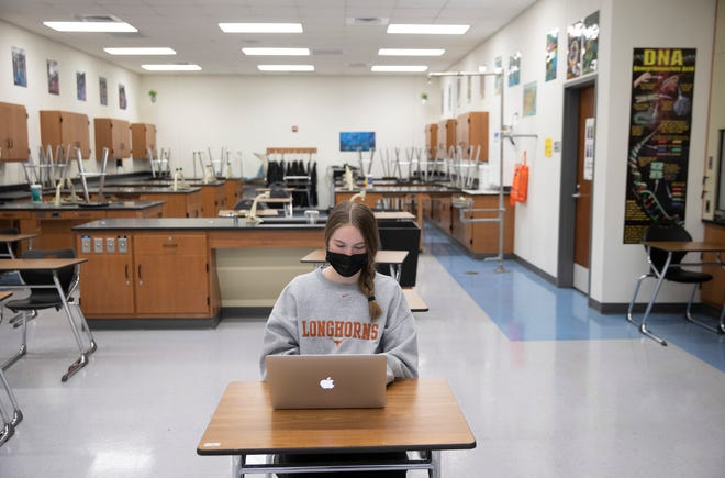 Sophie Fennell, 15, attends a biology class at Vandegrift High School last week. Texas public schools will get a big funding boost after state officials released federal coronavirus relief money.