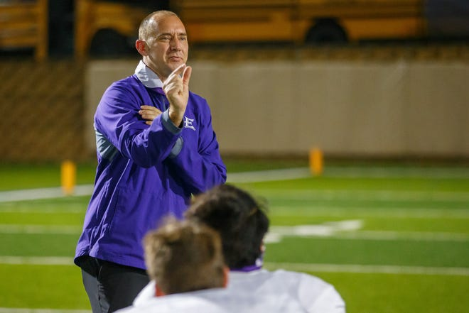 Elgin football coach Jens Anderson, gesturing to his team after a game against East View, is stepping down to become an assistant principal in the district.