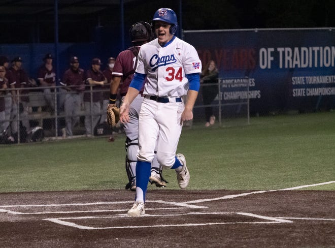 Westlake starting pitcher Braden Davis, who gave way to reliever Cole Foster midway through the game, scores the winning run in extra innings on a walk during the 10-9 win by Westlake over Austin High on April 20 at Westlake's Woerner Field.