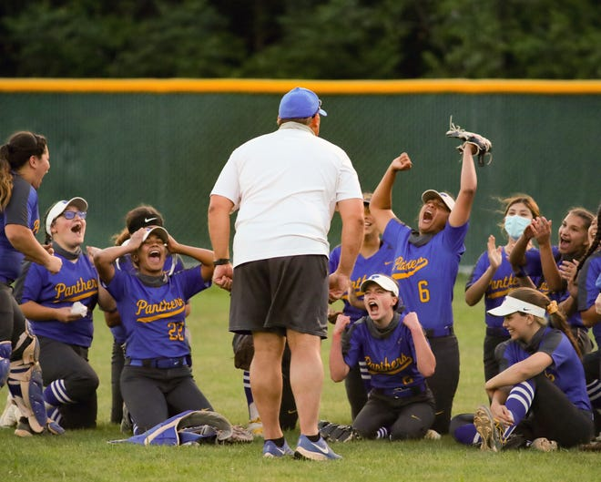 Pflugerville softball coach Matt Peterson and his team celebrate after winning a playoff seeding game against Elgin in District 18-5A April 20 at Connally High School. Pflugerville rallied to win 3-2 over Elgin and claim the district's top playoff seed.