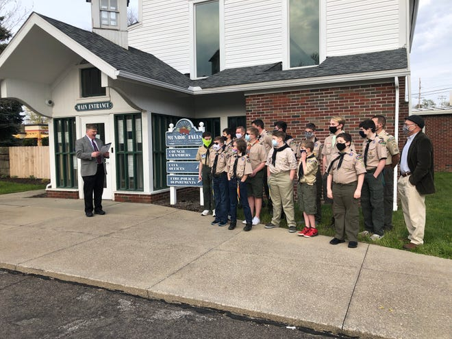 Munroe Falls Mayor James Armstrong reads a proclamation honoring Boy Scout Troop 172, whose camping trailer was stolen in March. Through a social media campaign, the troop exceeded their $10,000 fundraising goal and are donating the surplus to other troops.