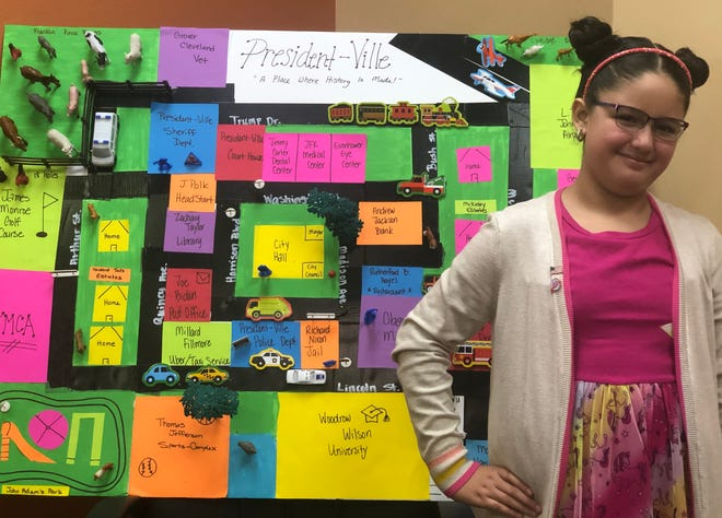 Chloe Valdez, third grader at Saenz Elementary, creates President-ville as a school project centered around her favorite subject.