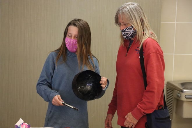 Kimber Haschke participates in the Empty Bowls event with her grandmother Karen Irving on Tuesday, getting the bowl that Kimber made.