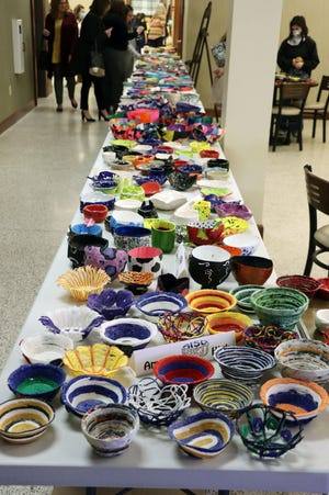 The Empty Bowls event at Polk Street United Methodist Church on Tuesday evening, which featured bowls made by area elementary through high school students, benefits Kids Cafe.