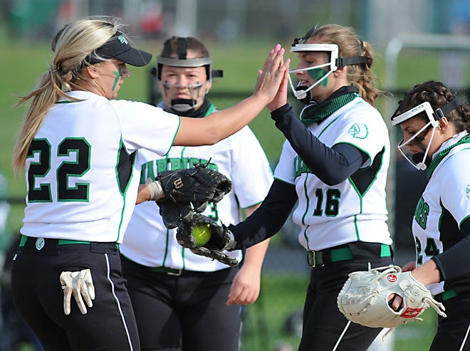 West Branch's Jordan Anderson celebrates with teammate Sydney Mercer (22) after recording a strikeout in an Eastern Buckeye Conference game against Salem.