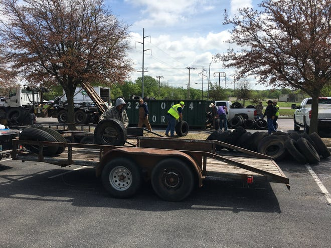 Volunteers and crews from Southern Oklahoma Rural Disposal collect old tires at the Earth First Expo on Saturday, April 17, 2021. Over 800 tires were collected for proper disposal.