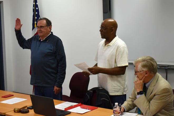 Harry Spring prepares to be sworn in for his second term on the Ardmore City Schools Board of Education Tuesday, April 20, 2021. Board members later voted to approve legal action against the State Board of Education for approving a lawsuit settlement that could divert local revenues toward charter schools.