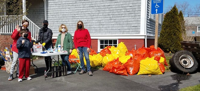 Pitching in during last Sunday's West Barnstable Village Cleanup are, from left, Drew and Gunnar Hall, co-organizer Marissa Caney, WBCA President Nancy Meagher and Meg Loughran.