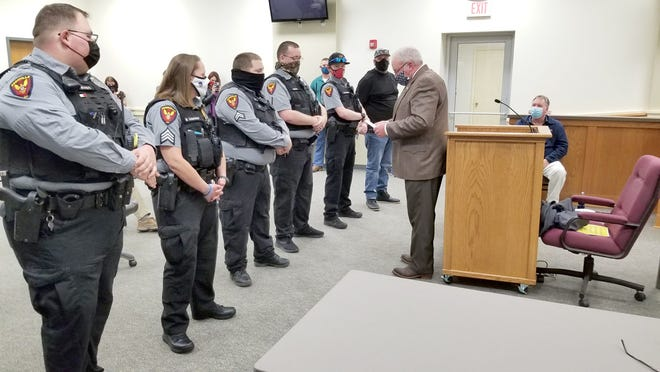 The Boonville Police Department received several awards Monday night during the Boonville City Council Meeting. The Boonville Police Department had two incidences, where they saved the life of individuals. Receiving the awards were (left to right) Ptl. Courtland Ross, Sgt. Maggie Schanzmeyer, Cpl. Michael Moore, Ptl. Clinton Barger, Ptl. Taylor Werkmeister, Brandon Roberts, Rep. Time Taylor. Each of the officers and Mr. Roberts received the following awards: Boonville Police Department Lifesaving Medal, Sons of the American Revolution Lifesaving Award, House Resolution for Lifesaving Presented by Rep. Tim Taylor, and Meritorious Service Award from Missouri Attorney General Eric Schmitt.   Letter from Missouri Governor Mike Parsons