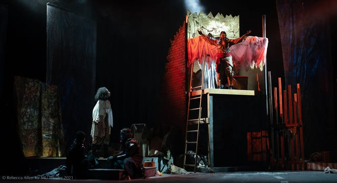 Marisol (DaJah Garrett) left, looks on as the Angel (Ayanna Taylor) sheds her wings of war in the play 'Marisol' at the Rhynsberger Theater.