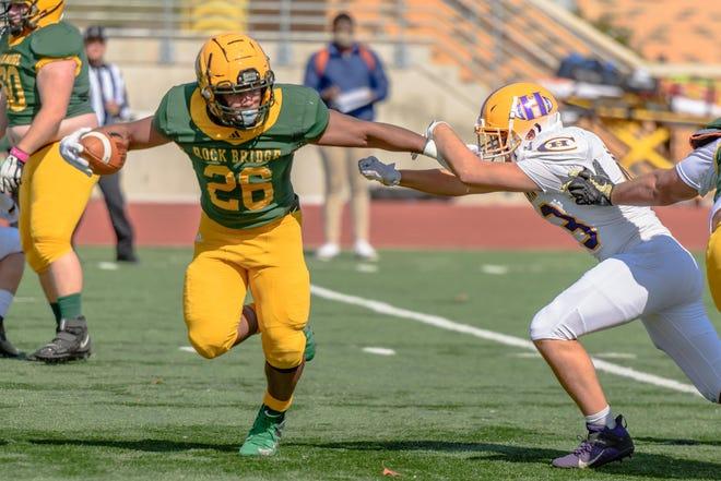 Rock Bridge's Bryce Jackson (26) runs the ball against Hickman on Oct. 17 at Rock Bridge High School.