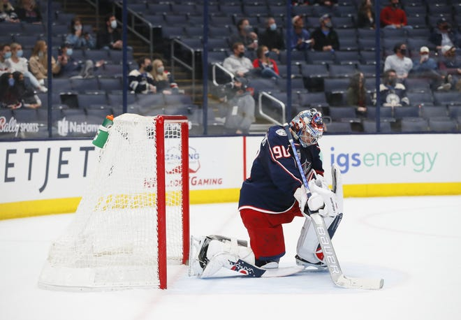 Blue Jackets goaltender Elvis Merzlikins kneels as officials review a goal by Tampa Bay's Ryan McDonagh during the second period on April 8. In the past seven games, the Blue Jackets have been outscored 15-3 in second periods.