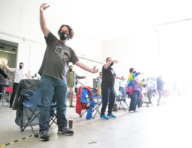 """Members of the Columbus Gay Men's Chorus rehearse dance moves to 1993 hit """"What's Up"""" by 4 Non Blondes in preparation for their first performance of the season."""