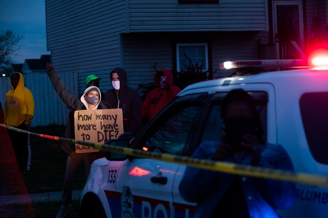 Demonstrators gather at the corner of Templar Street and Legion Lane following a fatal police shooting April 20.
