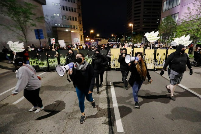 Protestors march in downtown Columbus on Tuesday, April 20, 2021 following a fatal police shooting earlier in the afternoon on the city's southeast side where 16-year-old Ma'Khia Bryant was shot and killed as officers responded to an attempted stabbing call.