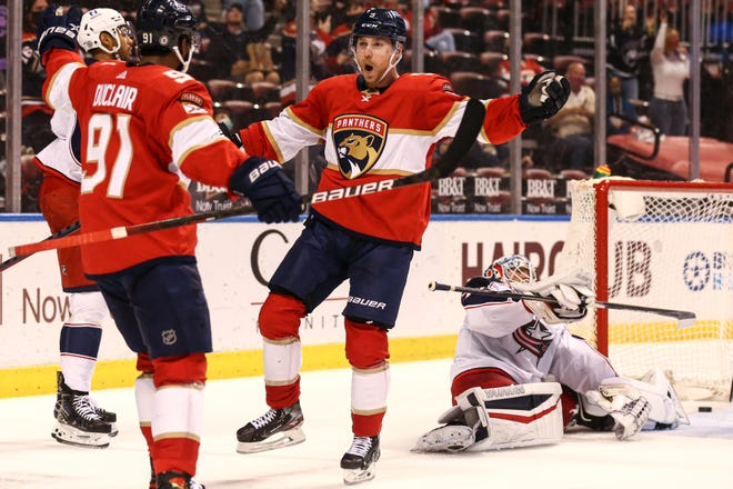 Apr 20, 2021; Sunrise, Florida, USA; Florida Panthers center Sam Bennett (9) celebrates  with left wing Anthony Duclair (91) after scoring a goal against the Columbus Blue Jackets during the second period at BB&T Center. Mandatory Credit: Sam Navarro-USA TODAY Sports