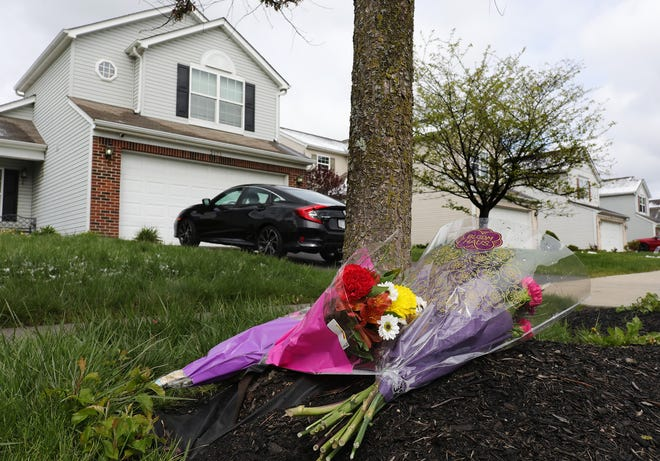 Flowers sit outside a foster home on Legion Lane where 16-year-old Ma'Khia Bryant was living when she was shot and killed by a Columbus police officer on April 20. Bryant and her sister had been previously living with her grandmother before moving into a foster home.